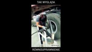 Kobieta zmienia opony w ciężarówce [Film]